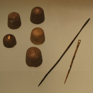 Thimbles and sewing needles in Museum of London.