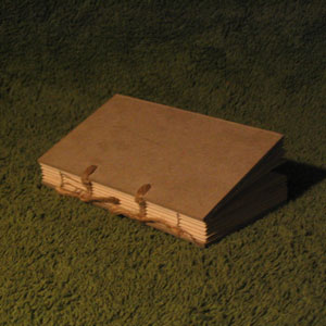 Uncovered book block, Carolingian style sewing