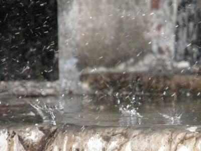 Rain on a doorstep, fast shutter speed.