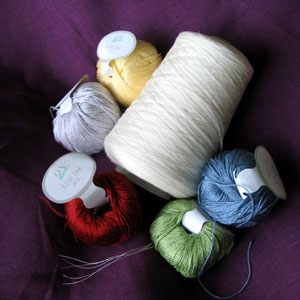 Linen thread for sewing and cotton-viscose for emboidery.